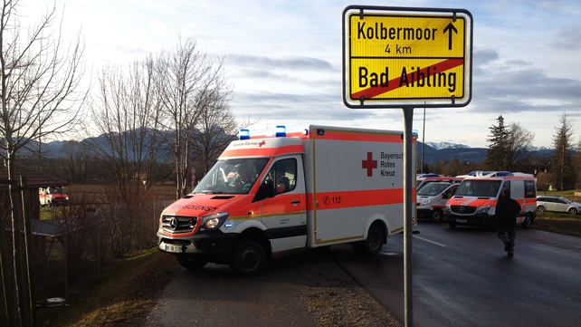 An ambulance next to an exit sign for Bad Aibling, Bavaria