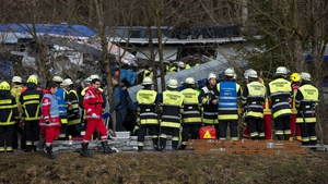 Rescue teams work at the site of the crash
