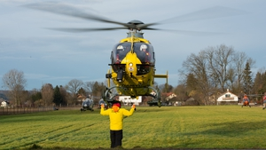 A helicopter leaves the scene of the crash