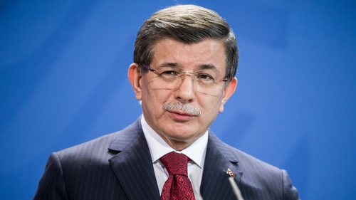 Turkish Prime Minister Ahmet Davutolgu said violence in the north of Aleppo had forced 200,000 people to flee