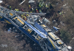 An aerial shot shows wreckage from both trains following the crash