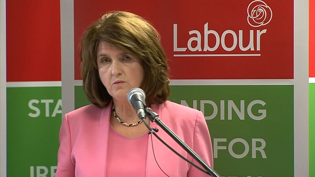 Joan Burton defended Labour's plan to cut the USC