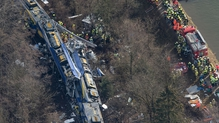 Aerial picture shows emergency services at the scene of the train crash in southern Germany