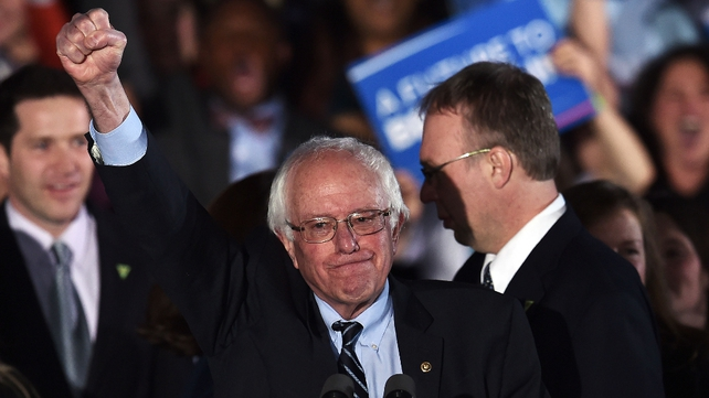 Bernie Sanders celebrates after his strong showing in New Hampshire
