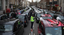 Taxi drivers are angry over lack of regulations for Uber drivers