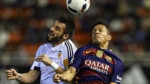 Alvaro Negredo (L) rises for a header with Adriano of Barcelona