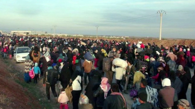 Large crowds of Syrians enter a refugee camp on the Turkish border in the town of Kilis (Pic: Facebook/IHH Humanitarian Relief Foundation)