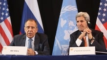 US Secretary of State John Kerry listens to Russian Foreign Minister Sergey Lavrov