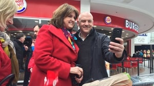 Smile for the camera - but tensions mount on campaign trail