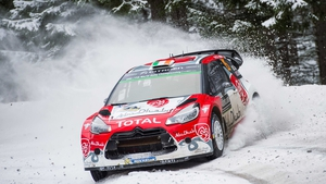 Craig Breen guides his Citroen DS 3 through the snow