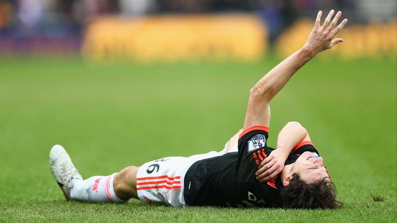 Matteo Darmian lies injured