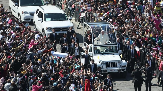 Pope Francis travels in the Popemobile after a welcome ceremony at the National Palace in Mexico City