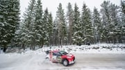 Breen steers his Citroen around the icy course at Rally Sweden
