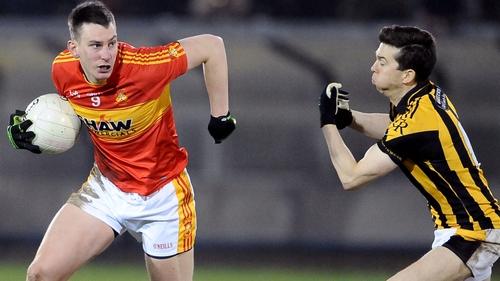Barry Moran (L) evades Stephen Kernan