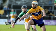 Clare's Conor McGrath and Niall Wynne of Offaly contest possession in Ennis
