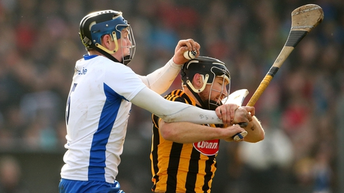 Austin Gleeson and Kilkenny's Richie Hogan battle for possession at Walsh Park