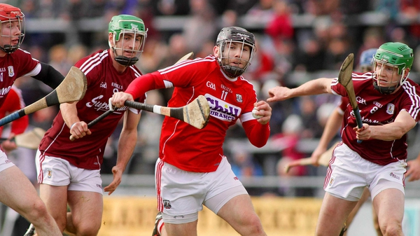 Paudie O'Sullivan of Cork is hounded by Galway's Padraig Mannion and Adrian Tuohy