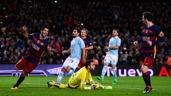 Luis Suarez rushes to Lionel Messi, who passed up the chance to net his 300th La Liga goal