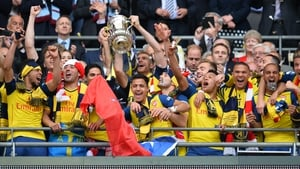 Arsenal players celebrate winning last year's FA Cup final at Wembley