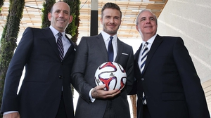 Beckham (centre) with MLS Commissioner Don Gerber and former Mayor of Miami Carlos Gimenez