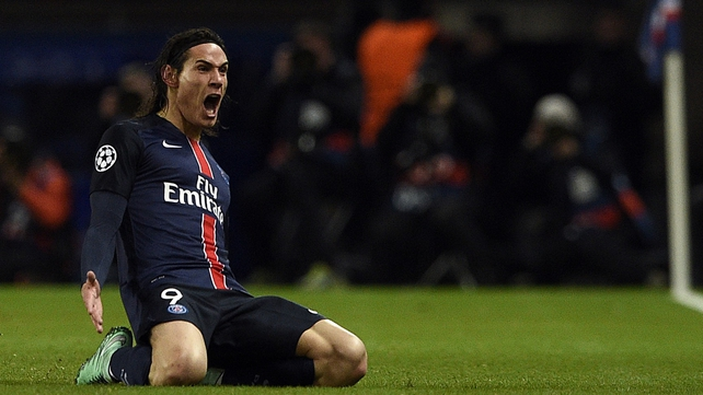 Edinson Cavani celebrates scoring the winner