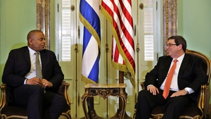 Cuban Minister of Foreign Affairs, Bruno Rodriguez (R) meets with US Secretary of Transportation, Anthony R. Foxx (L) in Havana