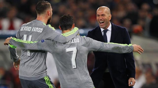Cristiano Ronaldo celebrates with Sergio Ramos and Zinedine Zidane after scoring the opening goal