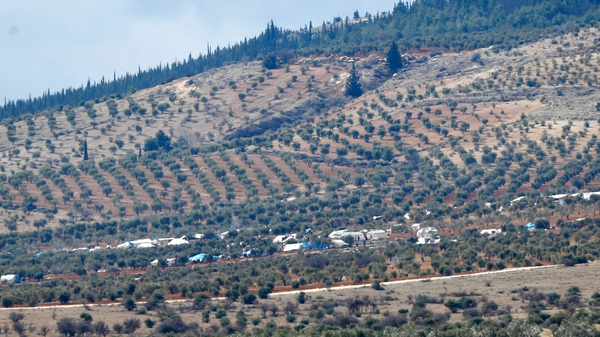 The rebel fighters were escorted across the border by Turkish forces over several nights