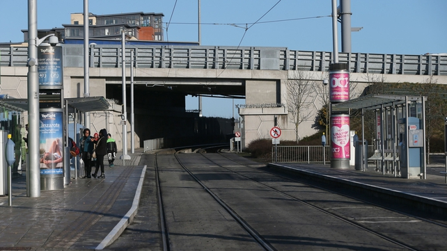 People at the empty Red Cow Luas stop