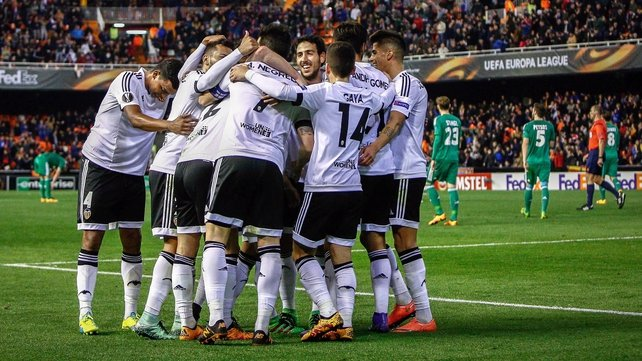 Valencia's players celebrate a goal against Rapid Vienna