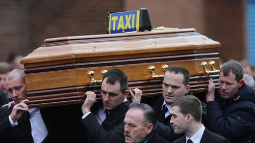 The coffin of Eddie Hutch is carried into Our Lady of Lourdes Church in Dublin