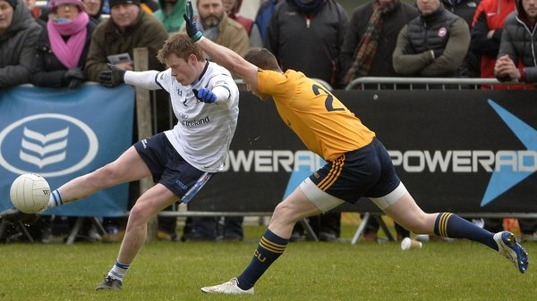 DCU's Michael Quinn attempts to block UUJ's Ricky Johnston