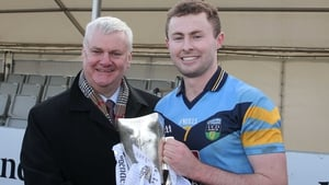 Jack McCaffrey (R) poses with the Sigerson Cup and GAA President Aogán Ó Fearghaíl last February