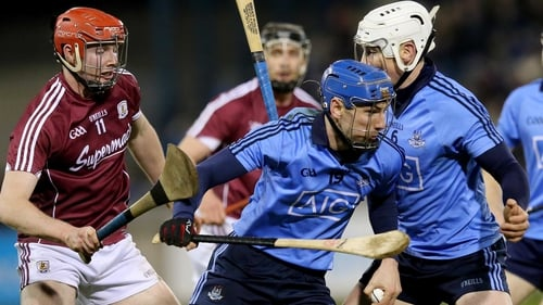 Dublin's Daire Plunkett twists away from Cathal Mannion