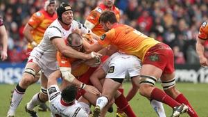 Ulster's Franco van der Merwe tries to halt Phil John