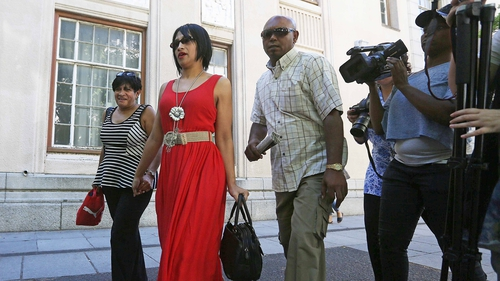 Celeste Nurse (2nd L), the mother of a South African girl who was abducted after birth in 1997, leaving the Cape Town magistrates' court