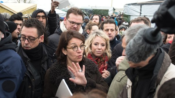 Judge Valerie Quemener was mobbed by journalists and migrants as she made her way round the site