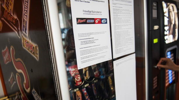 A note announcing the recall in Germany is seen on a vending machine in Berlin