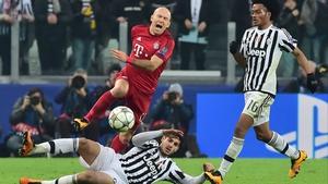 Juan Cuadrado (right) returns to Juventus