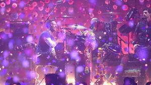 Coldplay performing on stage