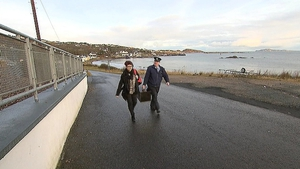 A Garda brings the ballot box to the polling station on Arranmore island
