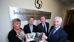 Richard McClean, MD of INM (2nd right), and Simon Snoddy, Finance Director of INM (2nd left) pictured with Gladys and James Greer