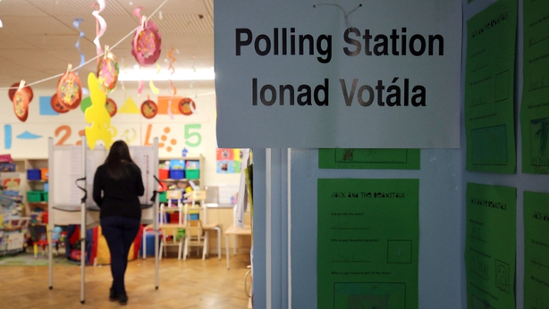 A voter casts her vote in Ballinlough, Co Cork