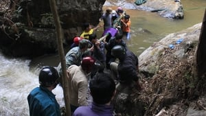 Rescuers carry one of three bodies of British tourists