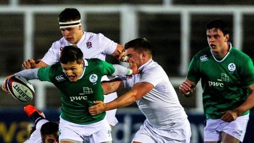 Ireland's Johnny McPhillips get's away from Jack Singleton
