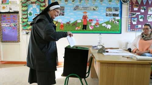 Sister Anastasia of the Franciscan order casts her vote at Knock National school, Mayo