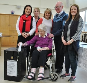 103-year-old Molly Loughman, one of the oldest women to vote in the election, casts her ballot in Castleblayney, Co Monaghan
