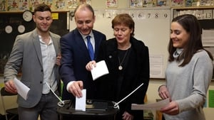 Fianna Fáil Leader Micheál Martin, casts his vote with family members son Micheál Aodh, wife Mary, and daughter Aoibhel at St Anthony's Boys Primary School in Ballinlough, Cork
