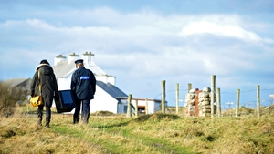 Garda Margaret Byrne carries a ballot box with Magella Harkin from a boat to the polling station on the Island of Innishfree, Co Donegal, where two people voted