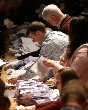 Ballot papers are verified as counting gets under way at the City Hall in Cork